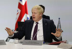 Britain's Prime Minister Boris Johnson gestures ahead of a working session on World Economy and Trade on the second day of the G-7 summit in Biarritz, France Sunday, Aug. 25, 2019. (AP Photo/Markus Schreiber)