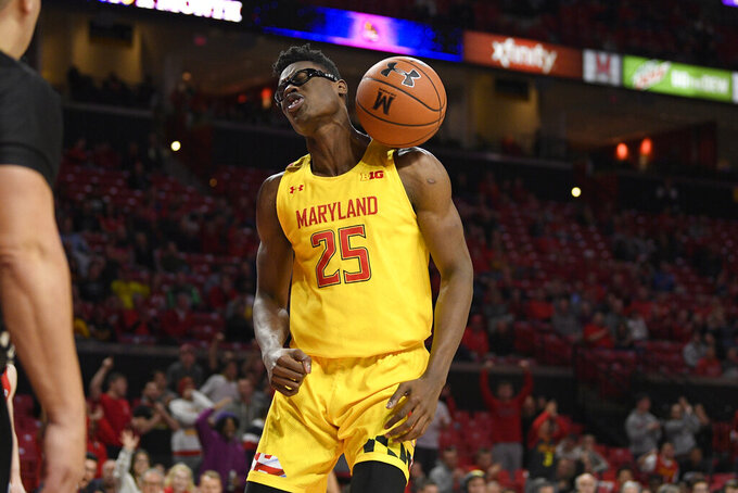 Maryland forward Jalen Smith (25) reacts after his dunk during the second half of the team's NCAA college basketball game against Fairfield, Tuesday, Nov. 19, 2019, in College Park, Md. Maryland won 74-55. (AP Photo/Nick Wass)
