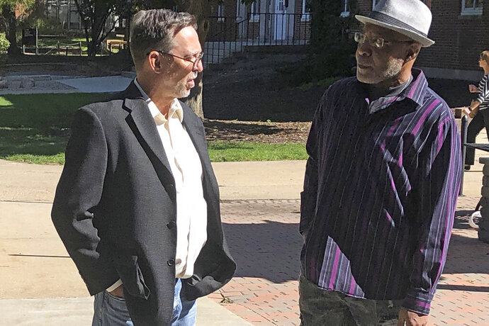 Terry Harrington, right, speaks with attorney Tom Frerichs on the Coe College campus in Cedar Rapids, Iowa, on Tuesday, Oct. 8, 2019. Harrington, who spent more than 25 years in an Iowa prison for a 1977 murder he did not commit, shared his experience with students on Tuesday, in his first public comments in years. (AP Photo/John Foley)