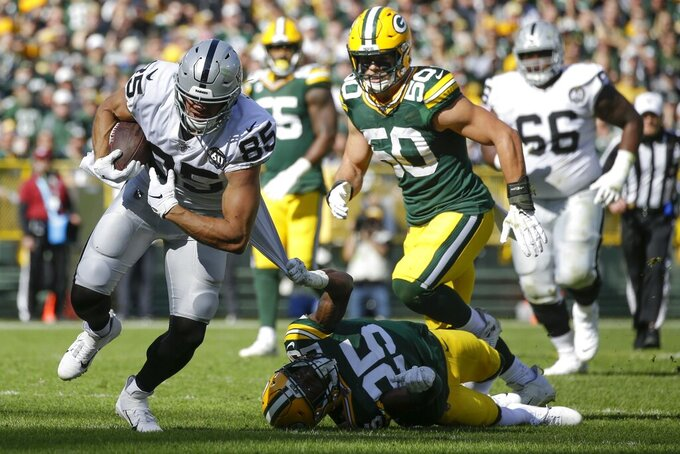 Oakland Raiders' Derek Carrier tries to get past Green Bay Packers' Will Redmond during the first half of an NFL football game Sunday, Oct. 20, 2019, in Green Bay, Wis. (AP Photo/Jeffrey Phelps)