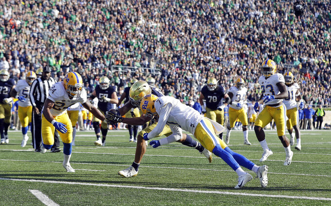Notre Dame wide receiver Chase Claypool (83) dives for a touchdown against Pittsburgh defensive back Phil Campbell III (24) and defensive back Jazzee Stocker during the second half of an NCAA college football game, Saturday, Oct. 13, 2018, in South Bend, Ind. Notre Dame won 19-14. (AP Photo/Darron Cummings)