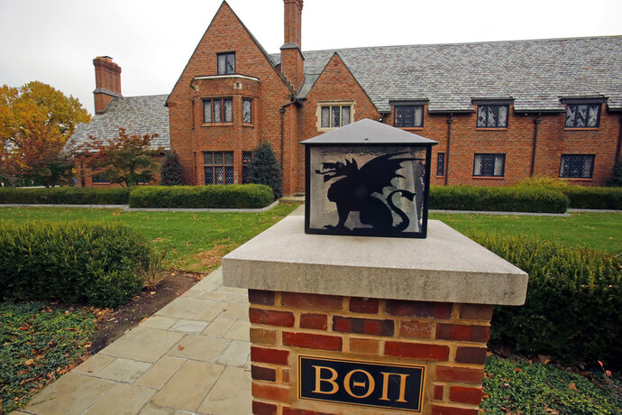 FILE - In this Nov. 9, 2017, file photo, the Beta Theta Pi's shuttered fraternity house on Penn State University's main campus is viewed in State College, Pa. A judge on Friday, Feb. 9, 2018, scheduled a six-day preliminary hearing in March 2018 for 11 Penn State fraternity brothers facing refiled charges in the Feb. 4, 2017, death of 19-year-old Tim Piazza, of Lebanon, N.J., after a night of heavy drinking. (AP Photo/Gene J. Puskar, File)