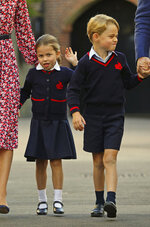 Britain's Princess Charlotte, center left, with her brother Prince George and their parents Prince William and Kate, Duchess of Cambridge, arrives for her first day of school at Thomas's Battersea in London, Thursday Sept. 5, 2019. (Aaron Chown/Pool via AP)