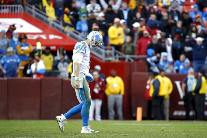 Detroit Lions quarterback Jeff Driskel leaves the field after being intercepted by Washington Redskins cornerback Quinton Dunbar during the second half of an NFL football game, Sunday, Nov. 24, 2019, in Landover, Md. The Redskins won 19-16. (AP Photo/Patrick Semansky)