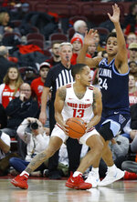 Ohio State's C.J. Walker, left, looks to pass the ball as Villanova's Jeremiah Robinson-Earl defends during the first half of an NCAA college basketball game Wednesday, Nov. 13, 2019, in Columbus, Ohio. (AP Photo/Jay LaPrete)
