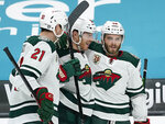 Minnesota Wild defenseman Ian Cole, celebrates with Ryan Hartman (38) and Carson Soucy (21) after scoring a goal against the San Jose Sharks during the second period of an NHL hockey game in San Jose, Calif., Monday, Feb. 22, 2021. (AP Photo/Tony Avelar)