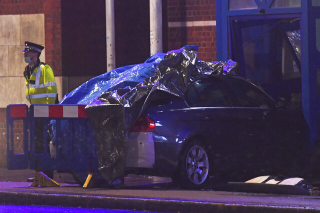 The Edmonton Police Station in Enfield, north London, where a man has been arrested after a vehicle collided with the station office, Wednesday, Nov. 11, 2020. There were no injuries reported, and it was unclear how the crash occurred. The vehicle remains at the scene and is being examined by specialist officers, police said. (Kirsty O'Connor/PA via AP)