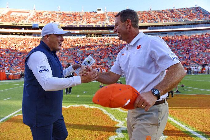 Clemson coach Dabo Swinney, right, greets Georgia Tech coach Geoff Collins before an NCAA college football game Thursday, Aug. 29, 2019, in Clemson, S.C. (AP Photo/Richard Shiro)
