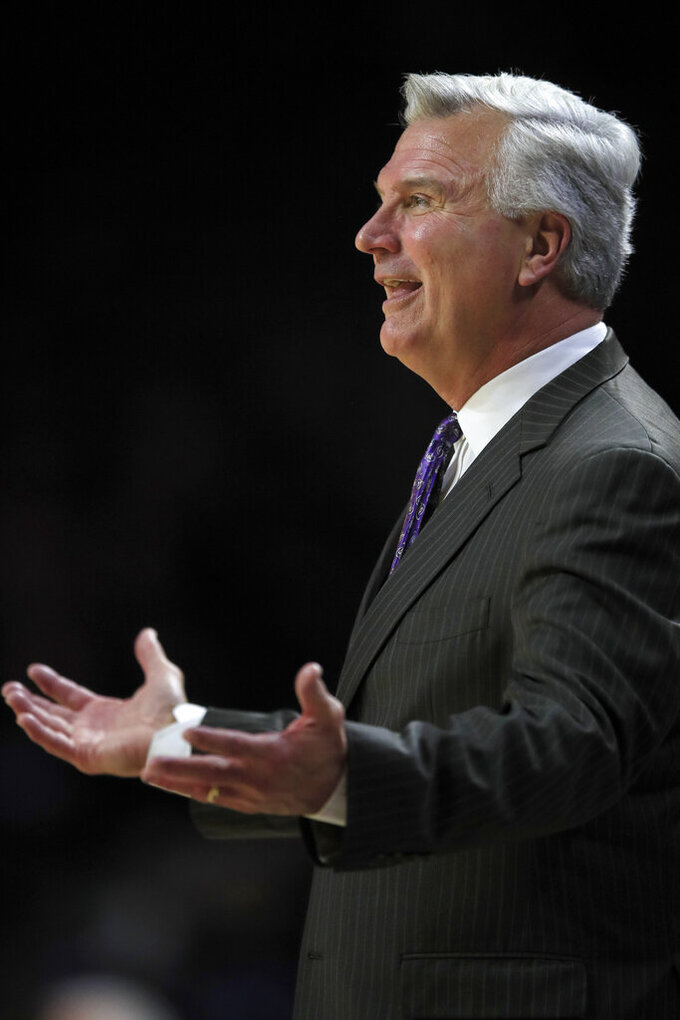 Kansas State head coach Bruce Weber questions a call during the first half of the team's NCAA college basketball game against Monmouth in Manhattan, Kan., Wednesday, Nov. 13, 2019. (AP Photo/Orlin Wagner)