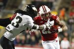 Wisconsin's Jonathan Taylor runs during the second half of an NCAA college football game against Purdue Saturday, Nov. 23, 2019, in Madison, Wis. (AP Photo/Morry Gash)