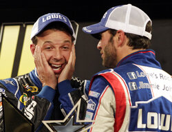 FILE - In this May 19, 2012, file photo, crew chief Chad Knaus, left, reacts with Jimmie Johnson after Johnson won the NASCAR Sprint All-Star auto race in Concord, N.C. Chad Knaus will move off the pit stand and into a management role with Hendrick Motorsports, ending his crew chief career after seven championships. Hendrick on Tuesday, Sept. 29, 2020, announced Knaus will move to vice president of competition. (AP Photo/Terry Renna, File)