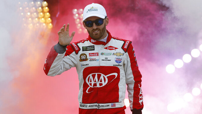 Austin Dillon waves to fans during driver introductions prior to the start of the NASCAR Cup series auto race at Richmond Raceway in Richmond, Va., Saturday, April 13, 2019. (AP Photo/Steve Helber)