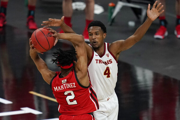 Southern California's Evan Mobley (4) guards Utah's Ian Martinez (2) during the second half of an NCAA college basketball game in the quarterfinal round of the Pac-12 men's tournament Thursday, March 11, 2021, in Las Vegas. (AP Photo/John Locher)