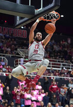 Stanford center Josh Sharma (20) dunks against UCLA during the second half of an NCAA college basketball game Saturday, Feb. 16, 2019, in Stanford, Calif. (AP Photo/Tony Avelar)