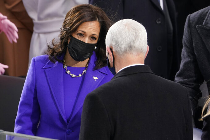 Vice President-elect Kamala Harris talks with Vice President Mike Pence during the 59th Presidential Inauguration at the U.S. Capitol in Washington, Wednesday, Jan. 20, 2021. (AP Photo/Andrew Harnik)