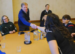 FILE - In this Feb. 26, 2019, file photo, NFL Commissioner Roger Goodell greets Dartmouth strength and conditioning intern Tessa Grossman and other participants, including Bear Lake High School offensive coordinator Sam Mullet, right wearing glasses, at the NFL Women's Forum held in Indianapolis. (AP Photo/AJ Mast, File)