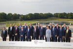 From left, Bank of Japan governor Haruhiko Kuroda, World Bank President David Malpass, Eurogroup President Mario Centeno, British Chancellor of the Exchequer Philip Hammond, Bank of Canada Governor Stephen Poloz, German Finance Minister Olaf Scholz, Federal Reserve Chair Jerome Powell, US Treasury Secretary Steve Mnuchin, Bank of England Governor Mark Carney, Bank of France Governor Francois Villeroy de Galhau, European Commissioner for Economic and Financial Affairs Pierre Moscovici, French Finance Minister Bruno Le Maire, Italian Economy and Finance Minister Giovanni Tria, Japan's Finance Minister Taro Aso, Organization for Economic Cooperation and Development (OECD) Secretary-General Angel Gurria, Canada's Finance Minister Bill Morneau, European Central Bank President Mario Draghi, German Bundesbank President Jens Weidmann, Bank of Italy Governor Ignazio Visco and International Monetary Fund (IMF) Deputy Managing Director David Lipton pose for a group photo at the G-7