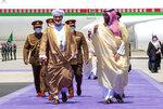 In this photo released by Saudi Royal Palace, Saudi Crown Prince Mohammed bin Salman, right, receives Omani Sultan Haitham bin Tariq, at Neom Bay Airport, in the Tabuk Province of northwestern Saudi Arabia, Sunday, July 11, 2021. (Bandar Aljaloud/Saudi Royal Palace via AP)