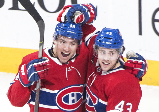 Montreal Canadiens' Jordan Weal (43) celebrates with Nick Suzuki after scoring against the Dallas Stars during the second period of an NHL hockey game Saturday, Feb. 15, 2020, in Montreal. (Graham Hughes/The Canadian Press via AP)