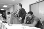 FILE - In this Oct. 2, 1982, file photo, Gene Upshaw, right, President of the National Football League Players Association, appears pensive as NFLPA executive director Ed Garvey speaks in Washington, after the group halted talks with NFL owners. (AP Photo/J. Scott Applewhite, File)