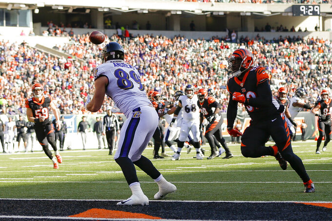 Baltimore Ravens tight end Mark Andrews (89) catches a touchdown pass against Cincinnati Bengals middle linebacker Preston Brown (52) during the first half of NFL football game, Sunday, Nov. 10, 2019, in Cincinnati. (AP Photo/Frank Victores)