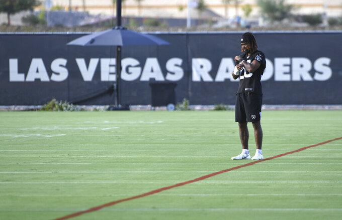 Las Vegas Raiders corner back Damon Arnette looks on during an NFL football practice Wednesday, July 28, 2021, in Henderson, Nev. (AP Photo/David Becker)