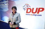 Democratic Unionist Party leader Arlene Foster poses on stage as she prepares for the the DUP annual party conference over the coming weekend in Belfast, Northern Ireland, Friday Oct. 25, 2019. Brexit dominates all political discussions at this time, as European Union ambassadors agreed Friday that the bloc should grant Britain's request for another extension to the Brexit deadline but have not yet figured out how long that delay should be.(Brian Lawless/PA via AP)
