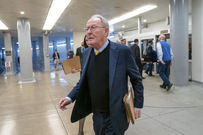 """FILE - In this Feb. 12, 2019, file photo, Sen. Lamar Alexander, R-Tenn., walks to the Senate at the Capitol in Washington. A new study says about once in every six times someone is taken to an emergency room or checks in to a hospital as an in-patient, the treatment is followed by a """"surprise"""" medical bill. (AP Photo/J. Scott Applewhite, File)"""