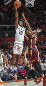 Illinois guard Andres Feliz (10) shoots next to Minnesota guard Isaiah Washington (11) during the first half of an NCAA college basketball game in Champaign, Ill., Wednesday, Jan. 16, 2019. (AP Photo/Rick Danzl)