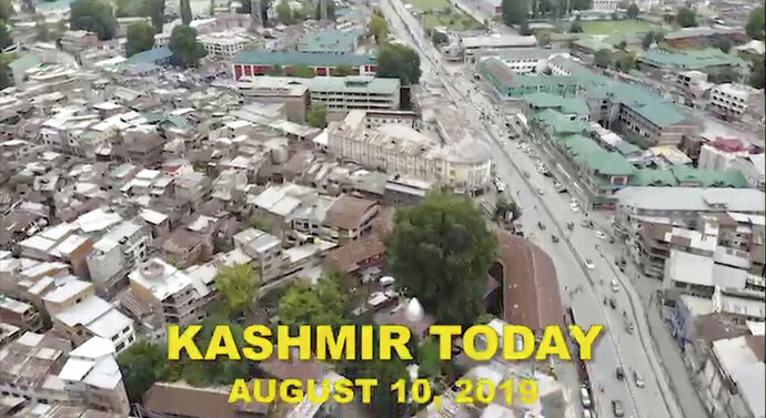 This image made from video released on Aug. 10, 2019, by the Jammu and Kashmir government purports  to show life returning to normal in Srinagar, Indian controlled Kashmir. Prime Minister Narendra Modi's Hindu nationalist-led government presented an order in parliament Aug. 5 revoking the autonomy of India's only Muslim-majority state, followed by a bill to split Jammu and Kashmir into two federal territories. On the eve of imposing this big political change, India shut down internet, phones and cable TV in the disputed region home to 12.5 million people. Officials have filled the void by circulating their own images and asserting the changes have widespread acceptance. But that portrayal hasn't stood up to scrutiny, with independent news reports suggesting otherwise. (Jammu and Kashmir government via AP)