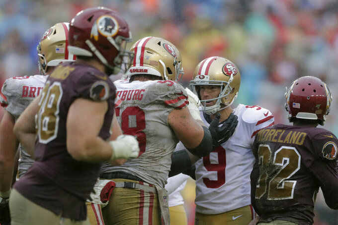 San Francisco 49ers kicker Robbie Gould (9) celebrates his successful field goal attempt with teammates in the second half of an NFL football game against the Washington Redskins, Sunday, Oct. 20, 2019, in Landover, Md. San Francisco won 9-0. (AP Photo/Julio Cortez)