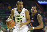 FILE - In this Dec. 4, 2017, file photo ,Baylor forward Tristan Clark (25) drives past Sam Houston State forward Bubba Furlong during the first half of an NCAA college basketball game in Waco, Texas. The Big 12 coaches picked Baylor to finish second in the league behind Kansas. (AP Photo/LM Otero, File)
