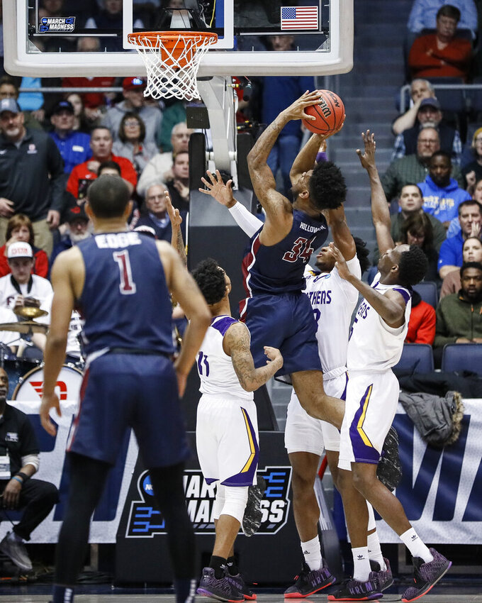 Fairleigh Dickinson's Mike Holloway Jr. (34) scores to take the lead during the second half of a First Four game of the NCAA college basketball tournament against Prairie View A&M, Tuesday, March 19, 2019, in Dayton, Ohio. (AP Photo/John Minchillo)