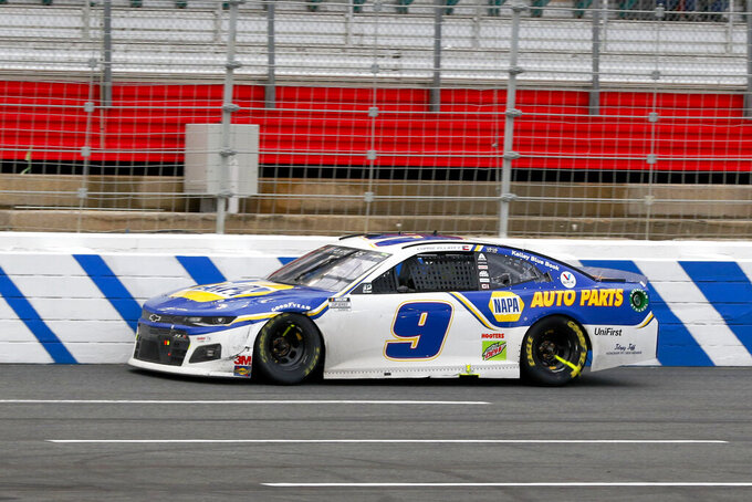 Chase Elliott drives down the fronth stretch on his way to winning a NASCAR Cup Series auto race at Charlotte Motor Speedway in Concord, N.C., Sunday, Oct. 11, 2020. (AP Photo/Nell Redmond)