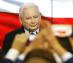 Leader of Poland's ruling party Jaroslaw Kaczynski speaks in reaction to exit poll results right after voting closed in the nation's parliamentary election that is seen crucial for the nation's course in the next four years, in Warsaw , Poland, on Sunday, Oct. 13, 2019. (AP Photo)