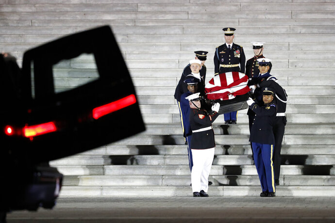 The flag-draped casket of Rep. Elijah Cummings, D-Md., is carried by members of the honor guard from the U.S. Capitol after lying in state in Washington, Thursday, Oct. 24, 2019. (AP Photo/Wilfredo Lee)