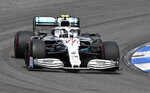 FILE - In this file photo dated  Saturday, July 27, 2019, Mercedes driver Valtteri Bottas of Finland steers his car during the qualifying Formula One session at the Hockenheimring racetrack in Hockenheim, Germany.  Mercedes has a point to prove at upcoming weekend's Hungarian Grand Prix, especially Valtteri Bottas after his crash at the German GP. (AP Photo/Jens Meyer, FILE)