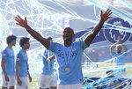 Manchester City's Vincent Kompany celebrates with his medal after the English Premier League soccer match between Brighton and Manchester City at the AMEX Stadium in Brighton, England, Sunday, May 12, 2019. Manchester City defeated Brighton 4-1 to win the championship. (AP Photo/Frank Augstein)