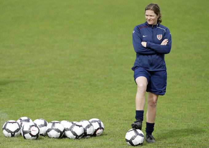 FILE - In this file photo dated Sunday, Feb. 28 2010, Hege Riise, from Norway, assistant coach of the United States Women's Soccer team, watches the players during a training session, in Guia, southern Portugal.  Hege Riise will temporarily take over as coach of the England women's national soccer team following Phil Neville's departure. (AP Photo/Armando Franca, FILE)