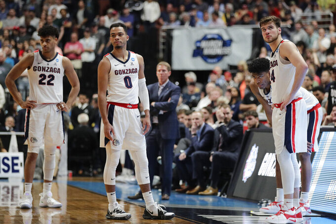Gonzaga players react to a loss to Texas Tech during the West Regional final in the NCAA men's college basketball tournament Saturday, March 30, 2019, in Anaheim, Calif. Texas Tech won 75-69. (AP Photo/Jae C. Hong)
