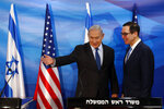 Israeli Prime Minister Benjamin Netanyahu gestures while standing next to U.S. Treasury Secretary Steven Mnuchin as they prepare to deliver joint statements during their meeting in Jerusalem, Monday, Oct. 28, 2019. (Ronen Zvulun/Pool Photo via AP)