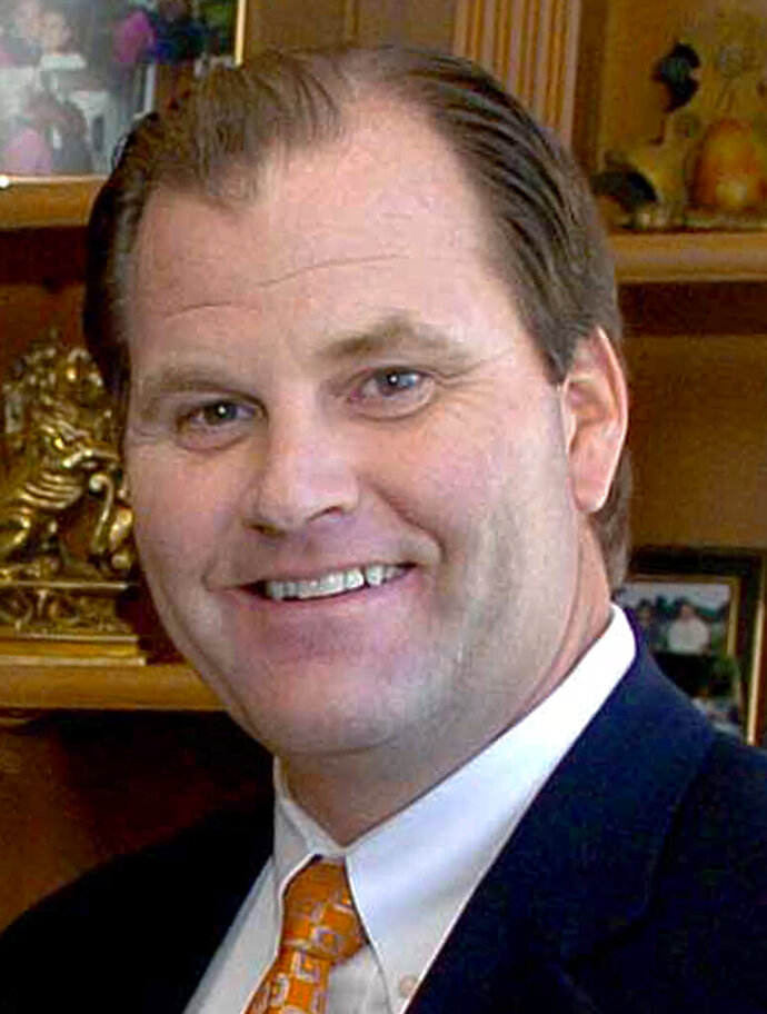 FILE - This July 13, 2003, file photo shows Mark Hauser at his home in the Indian Hill suburb of Cincinnati. Hauser, an insurance and private equity executive, is scheduled to plead guilty on Tuesday, Sept. 21, 2020, to charges in a college admissions bribery scheme. (Craig Ruttle/The Enquirer via AP, File)