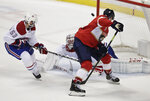 Florida Panthers center Aleksander Barkov shoots and scores against Montreal Canadiens goaltender Carey Price during the second period of an NHL hockey game against the, Sunday, Feb. 17, 2019, in Sunrise, Fla. (AP Photo/Brynn Anderson)