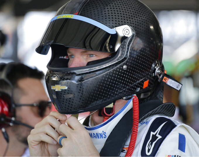 Dale Earnhardt Jr. prepares to get in his car before practice for a NASCAR auto race on Friday, Aug. 30, 2019, in Darlington, S.C. Earnhardt is scheduled to run in the Xfinity race on Saturday. (AP Photo/Terry Renna)