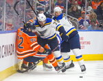 St. Louis Blues' Justin Faulk (72) pushes Edmonton Oilers' Tomas Jurco (92) off the puck, next to Blues' Jay Bouwmeester (19) during the second period of an NHL hockey game Wednesday, Nov. 6, 2019, in Edmonton, Alberta. (Amber Bracken/The Canadian Press via AP)