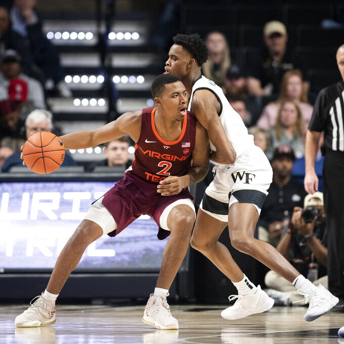 Virginia Tech guard Landers Nolley II (2) dribbles into defense from Wake Forest forward Isaiah Mucius (1) during an NCAA college basketball game Tuesday, Jan. 14, 2020 in Winston-Salem, N.C. (Andrew Dye/Winston-Salem Journal via AP)