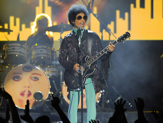 FILE - In this May 19, 2013, file photo, Prince performs at the Billboard Music Awards at the MGM Grand Garden Arena in Las Vegas. A Minnesota medical board has disciplined Dr. Michael Schulenberg, who treated Prince for prescribing pain medication for the pop megastar in another person's name. (Photo by Chris Pizzello/Invision/AP, File)