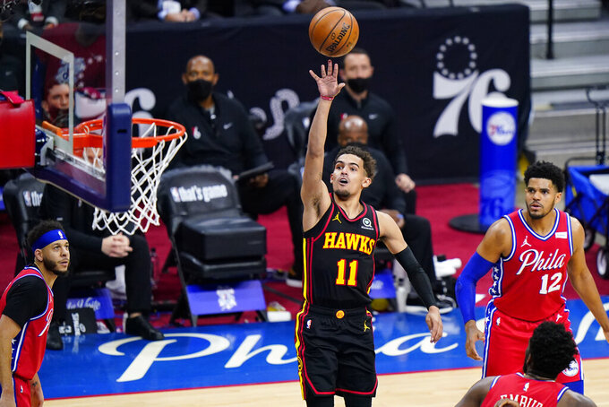 Atlanta Hawks' Trae Young goes up for a shot during the second half of Game 1 of a second-round NBA basketball playoff series against the Philadelphia 76ers, Sunday, June 6, 2021, in Philadelphia. (AP Photo/Matt Slocum)