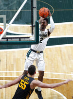 Michigan State's Rocket Watts (2) shoots against Iowa's Luka Garza (55) during the second half of an NCAA college basketball game, Tuesday, Feb. 25, 2020, in East Lansing, Mich. Michigan State won 78-70. (AP Photo/Al Goldis)