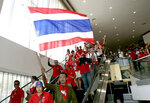 FILE- in this April 11, 2009, file photo, anti-government demonstrators storm past soldiers as they force their way into the 14th ASEAN Summit convention hall in Pattaya, Thailand. Thailand's Supreme Court has affirmed the prison sentences of 12 members of the